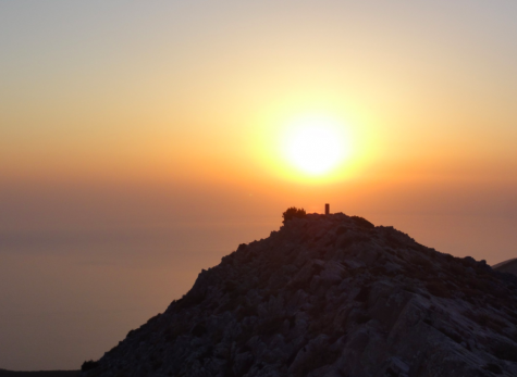 A sunset on the Greek island of Sifnos, where COVID-19 cases are now increasing throughout Greece as we head into the winter months of 2020-2021; COVID-19 cases are increasing in much of the world.