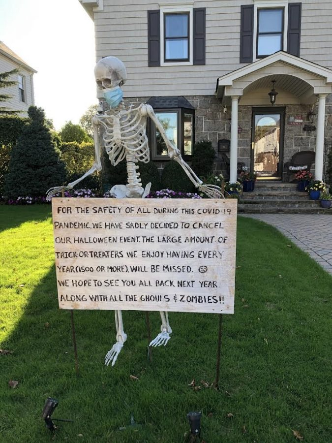 Pictured is a house in Bayside, Queens, during the days leading up to Halloween. Signs of warning were displayed on many NYC lawns in order to ensure that trick or treaters stayed safe and socially distanced from one another during Halloween 2020, which occurred during the novel Coronavirus pandemic.