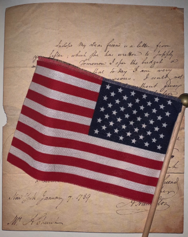 An American flag looms over a primary source document, one that is similar to documents that Bronx Science students analyze in their Advanced Placement American Studies classes.