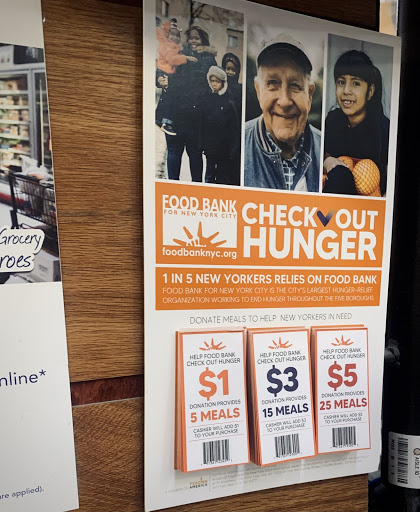Flyers from the hunger-relief organization, Feeding America, can be seen at the register of a local grocery store in New York City.