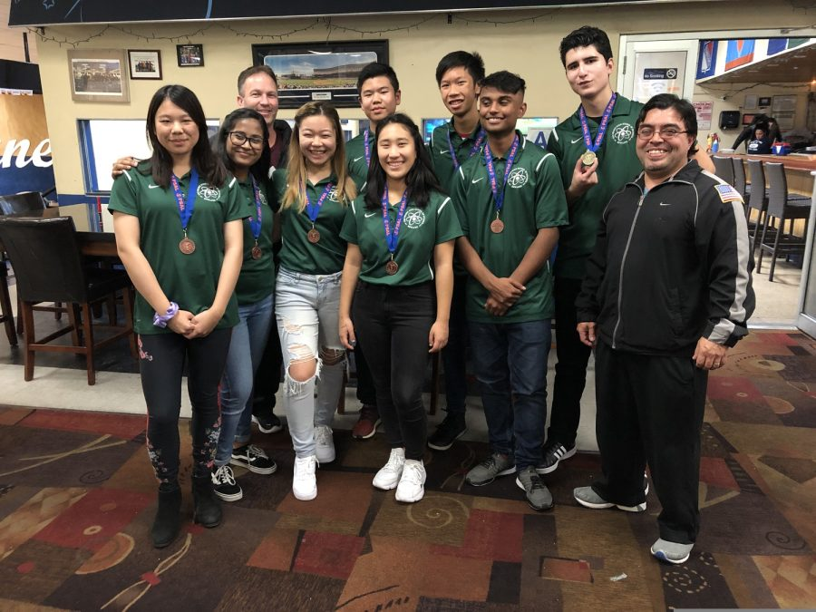 "Members of Bronx Science's Boys' and Girls' Varsity Bowling teams pose for photographers after placing in the Borough Individual Championships. ""Recognition for the bowling team's achievements is meaningful because it recognizes all of the time and dedication that my teammates and I have put into the sport that we love,"" said Skye Lam '22, a member of the Boys' Varsity Bowling team. Pictured (Left to Right): Starr Lam '20, Suporna Das '20, Coach for the Girls' Varsity Bowling team Mr. William O'Hara, Yi Qi (Angel) Zhu '20, Skye Lam '22, Jiwon (Ester) Yi '20, Russell Kwong '21, Rasheed Hossain '20, Luke Chavez '20, Coach for the Boys' Varsity Bowling team Mr. Patrick Daughton."