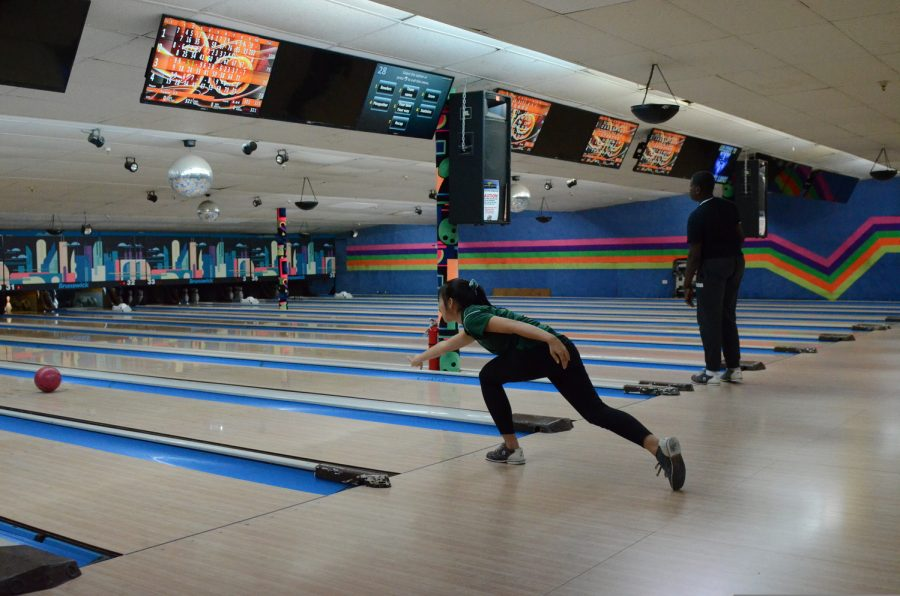 """Vanessa Fang '21, a member of the Girls' Varsity Bowling team, shows concentration and skill at a bowling game. """"The only fans I need are my teammates. We all enthusiastically cheer for each other for knocking down 1 pin to all 10 pins,"""" said Fang."""