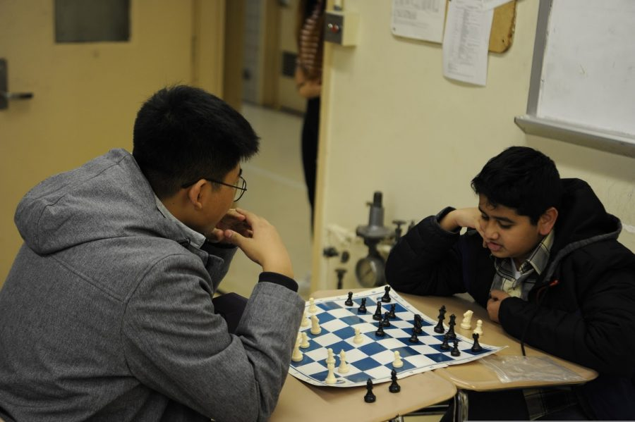 "Members of the Bronx Science Chess Club play chess in 2019, before the Coronavirus pandemic stopped in-person activities. This year, the club continues to stay active. ""Chess Club adapted well to the virtual world,"" said Asif Anzum '21, Vice President of the Bronx Science Chess Club. ""We have been playing chess with each other online, and we plan on teaching chess strategies, watching chess videos, streams, and movies together."""