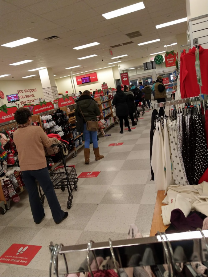 T.J. Maxx customers try their best to socially distance while waiting in line to purchase their items in December 2020, during the Coronavirus pandemic.