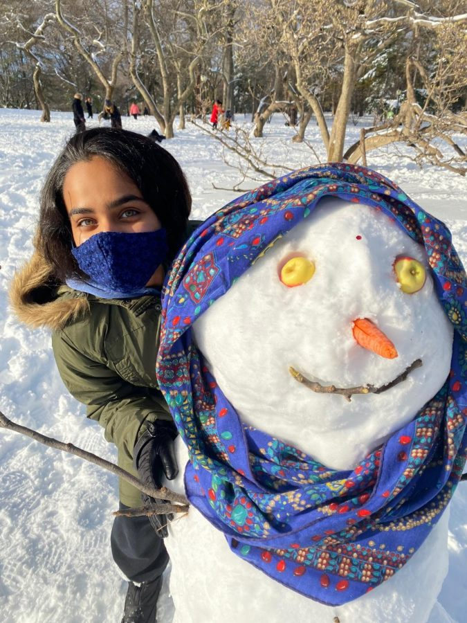 Zoya Garg '21 hugs the Indian snowwoman, named Bindya, that she and her little brother built in Central Park.