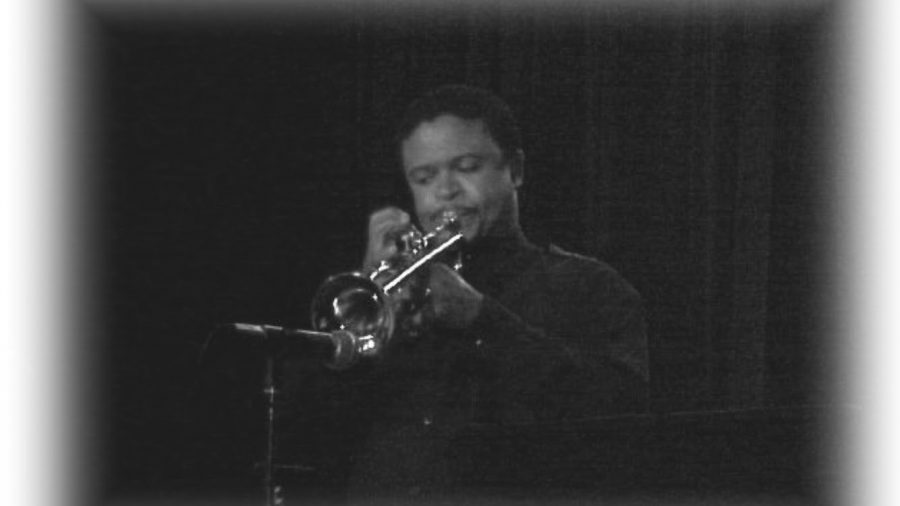 "Dr. Archer plays his trumpet in a performance. ""I've had people come up to me and tell me that the music I played made them feel good. When I perform, the tables shift in a sense that my job is to affect the audience. The music is coming from me and going out to the audience."""