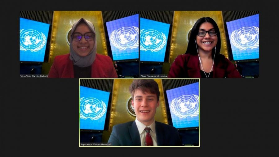 Samama Moontaha '21, Namira Mehedi '21, and Vincent Harwood '23, members of the Bronx Science Model United Nations team, lead the Disarmament and International Security Committee (DISEC).
