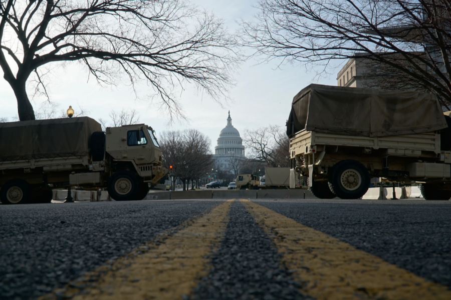 Military vehicles line Pennsylvania Avenue during the days leading up to Biden's inauguration. The violence incited by Trump created a tense atmosphere as Democrats rushed to file articles of impeachment and stave off future violence from Trump supporters.