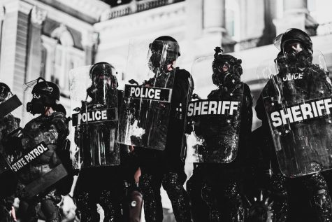 Police lined up in riot gear during the January 6th, 2021 Capitol riot.