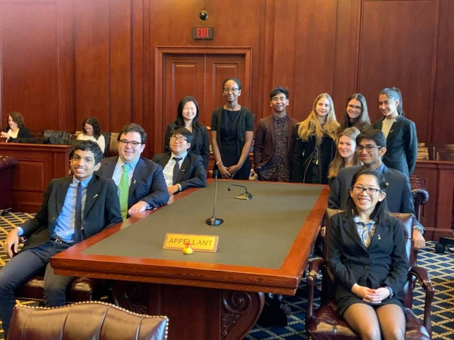 Here is the 2020 Bronx Science Mock Trial Team at a competition, before the Coronavirus pandemic changed everything. Last year, the team competed in front of a judge in a court room. This year, all competitions are conducted via Zoom, due to the pandemic.