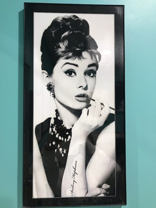 Audrey Hepburn is pictured in her iconic look from the film 'Breakfast at Tiffanys,' where she took on the role of Holly Golightly, proving that she could play characters outside of the innocent ingénue.
