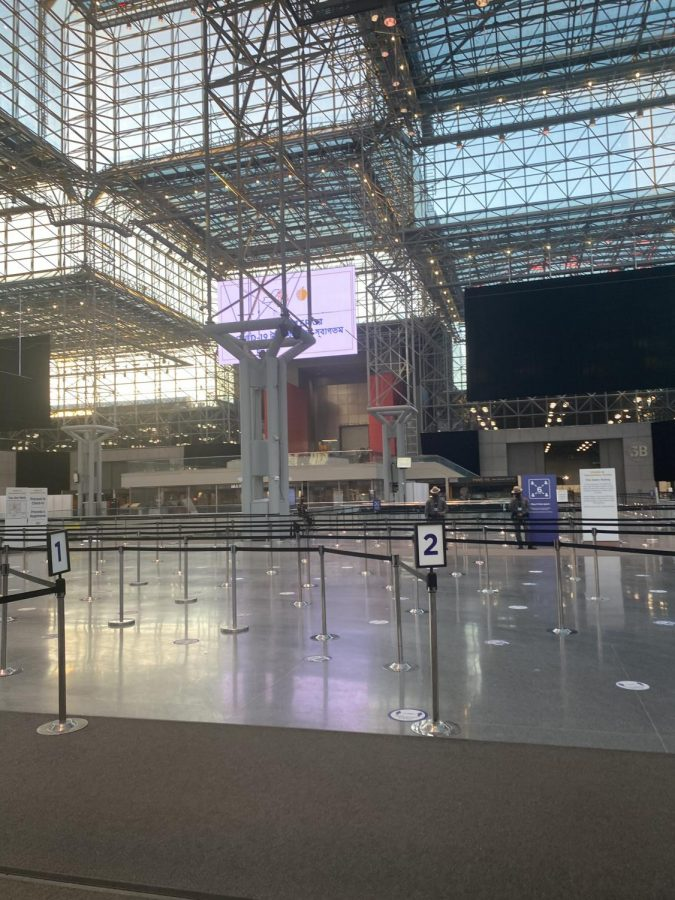 When you first enter Javits Center for your vaccine appointment, this is what you will see across the span of the lobby. In this photograph, taken in the late afternoon, it is entirely empty, but earlier in the day, it is often busier.