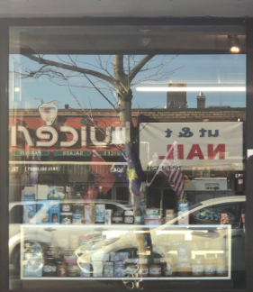 Here is a storefront featuring Albanian, Kosovar, and American flags.