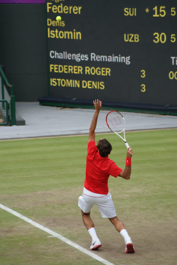 Roger Federer, a member of the Big Three, serves the ball in a match against Denis Istomin, during the 2012 London Olympics.