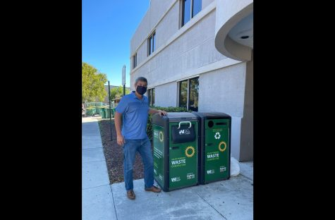 """Gruson stands next to BigBelly waste and recycling units. Although recycling is useful, """"recyclable does not mean impact-less,"""" he warns, as is still a form of disposal. Consuming less and repairing are better alternatives — that"""