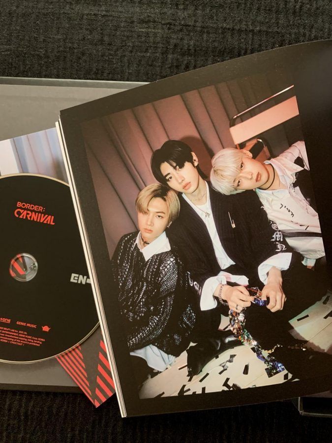 The physical album of 'Border: Carnival' has three versions: Hype, Up, and Down. Each version has its own unique concept, but all albums come with a photo book, a CD, a lyric book, two photo cards, a lenticular card, signature stickers, a carnival ticket, and a folded poster. Members Jay, Sunghoon, and Sunoo, pictured from left to right respectively, pose for their subunit photos that can be found in the photobook.