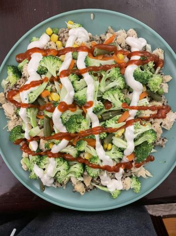 """""""Protein-rich meals are the most important part to building muscle. The extra sauce helps me to meet my daily intake goals of 3,100 calories and makes everything tasty, said Shams Rupak 21."""
