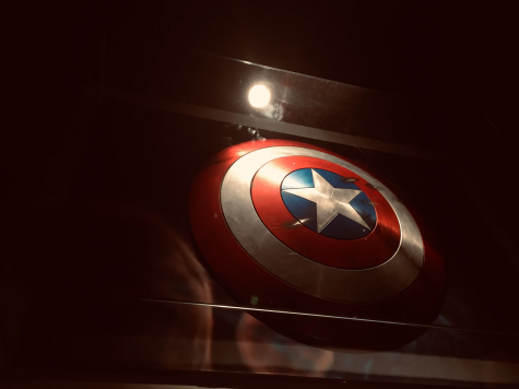The shield depicted is most commonly associated with Steve Rogers, better known as his superhero alter ego Captain America.  At the end of