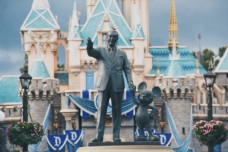Walt Disney's global empire has made great strides in representing diversity over the last decade. Pictured is a statue of Walt Disney with his character Mickey Mouse at Disneyland.