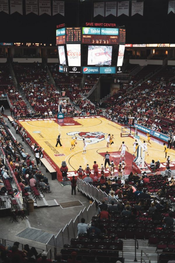 """""""When college teams start paying their athletes, it will make the fans question who they're rooting for — the team that they associate themselves with, or the player themselves,"""" said Ellie White of Northfield, Michigan."""