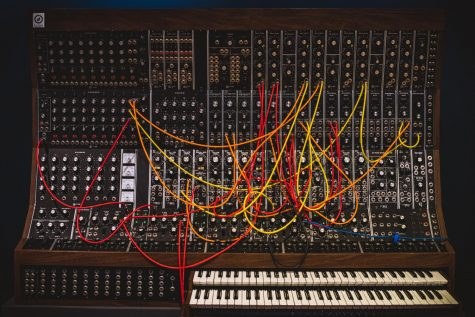 Here is the Moog Synthesizer designed by Robert Moog. One of the first synthesizers used in music, it allowed musicians to create their own sounds and to express themselves in an entirely new way. Albums such as L.A Lady by The Doors and Abbey Road by The Beatles implemented this version of the Moog.